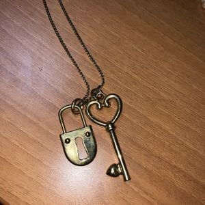 Gold Ann Taylor necklace with heart key and lock